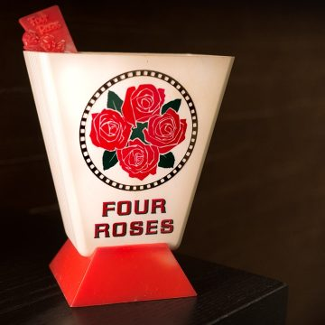 This was a barware promotional item that was used to promote the new label design for Four Roses Blended Whiskey in the United States.  It was a handy way to exhibit stir sticks in both the bar and at home in special bar kits available through the mail.