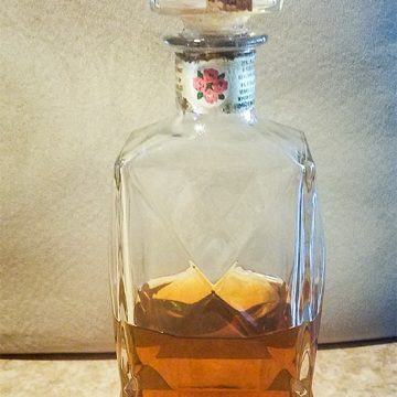 "This decanter was used for the Four Roses holiday package in 1968 and has been featured in an advertisement that read ""Say it with Roses! The Great American Spirit."""