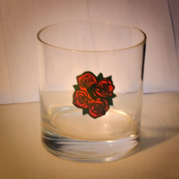 This type of glass featuring the Four Roses logo dates back to the 1950s when the brand was so well known that the roses on the glass were considered just enough.
