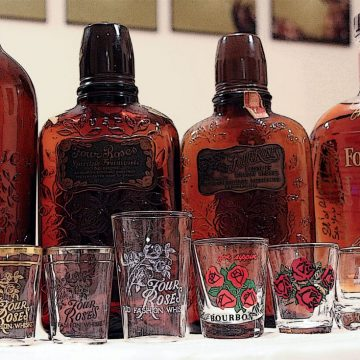 (Left to right) A bottle from 1919, the 1930s, 1940s and 2013 along with a variety of Four Roses shot glasses